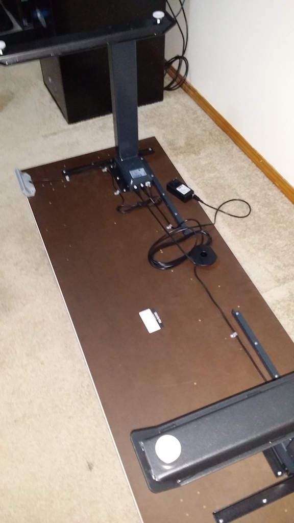 Desk with legs and electronics mounted